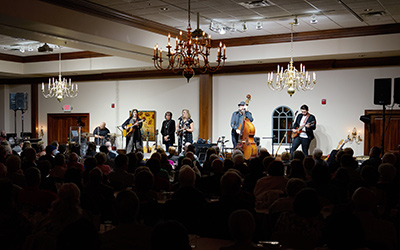 A music group performing for an audience at the Hartville Kitchen