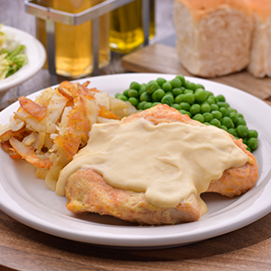 Picture of Baked Bonelesss Chicken Breast on a Plate with Green Peas