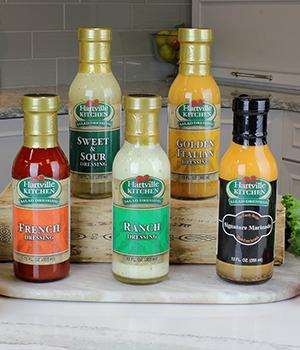 five different bottles of Hartville Kitchen shelf stable salad dressing