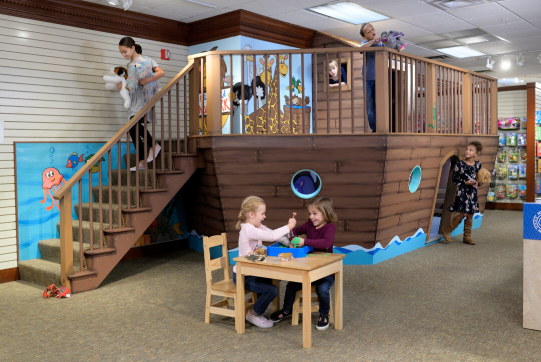 Kids playing on a Noah's Ark in the Children's Shop at Hartville Kitchen