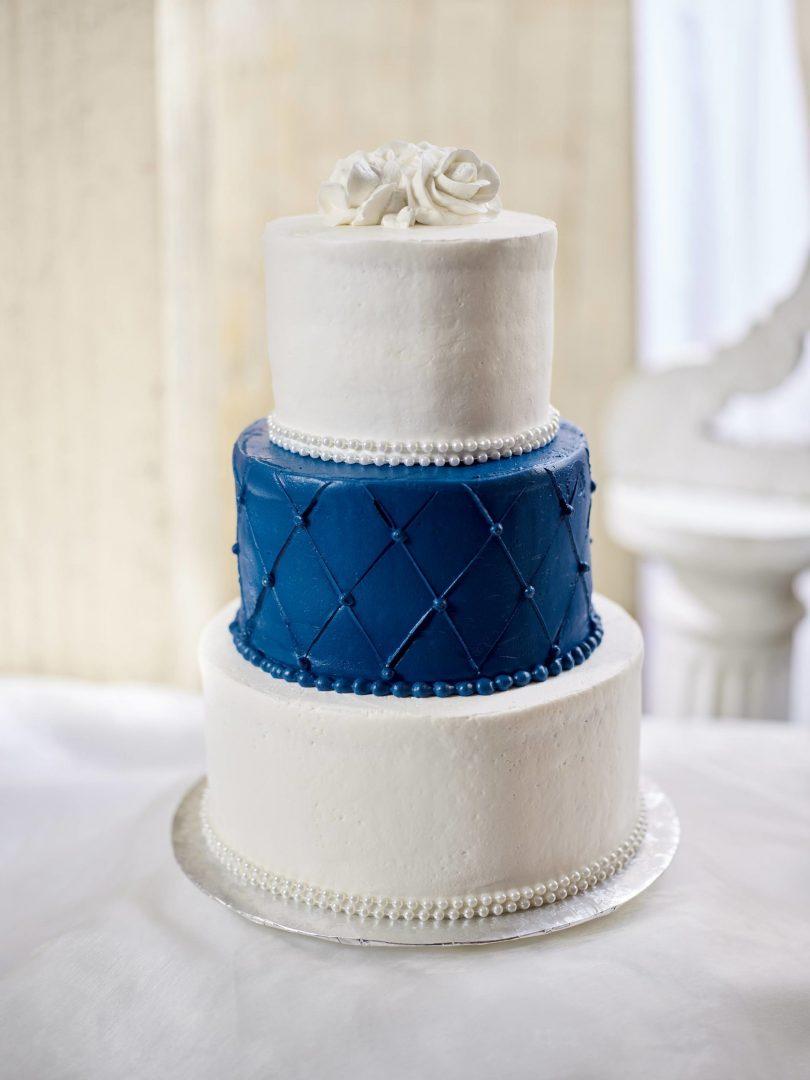 Three tiered modern blue and white wedding cake